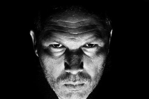 Low key portrait of menacing looking caucasian man