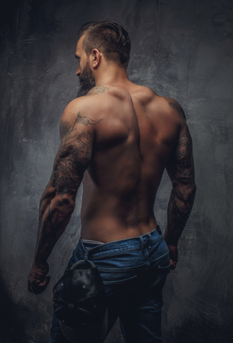 Shirtless muscular guy from back.